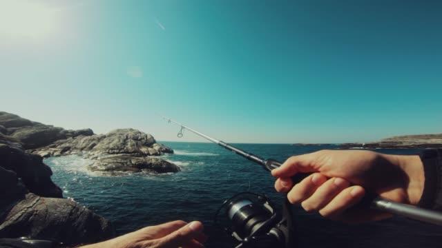 pov man fishing in the sea - fiordo video stock e b–roll