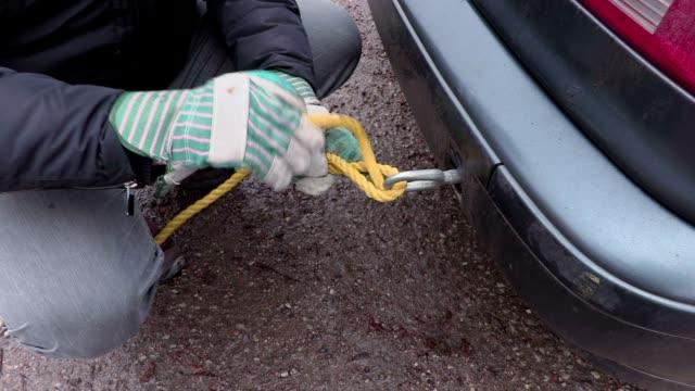 man fix rope in car tow bar - rimorchiatore video stock e b–roll