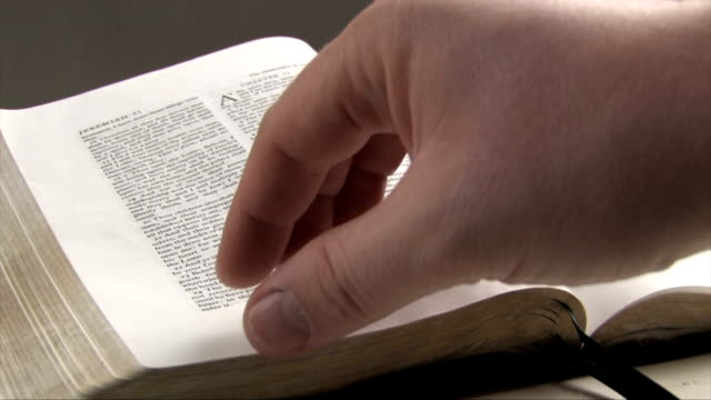 man flips through bible pages - christianity stock videos & royalty-free footage