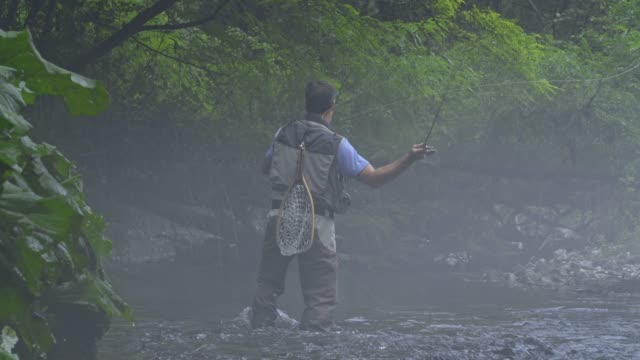 Man Fly Fishing in Vermont