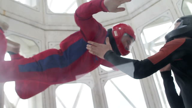 Man flying in a wind tunnel video