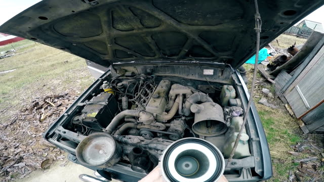 POV Man fumbling with the old machine in the engine compartment. Full HD video