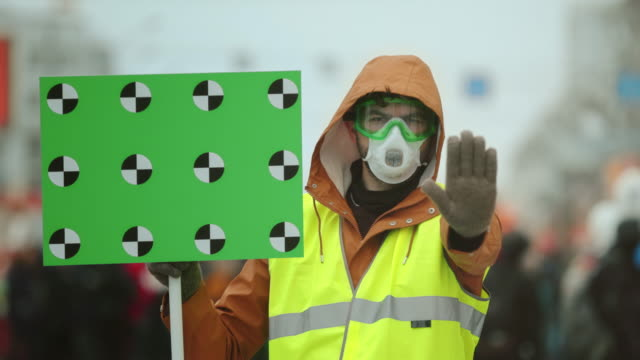 man gasmask hand gesture. stop environmental pollution. people look at camera. - traccia video stock e b–roll