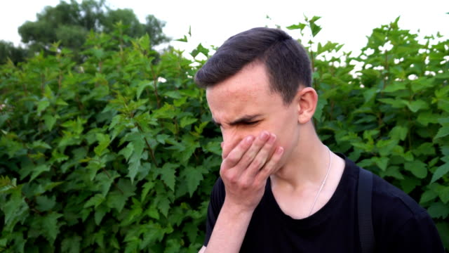 Man gestures a bad smell with his hand, closes his nose with his hands and acts nausea video