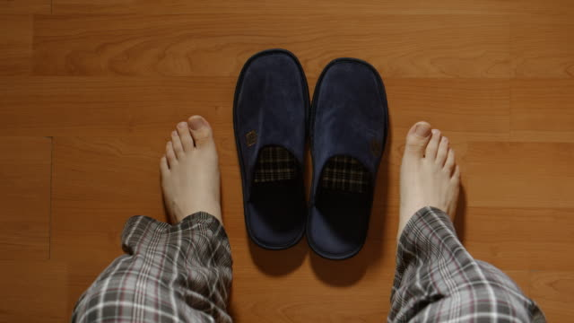 top view: man gets up from a bed in the night then wears a slippers and goes - pajamas stock videos & royalty-free footage