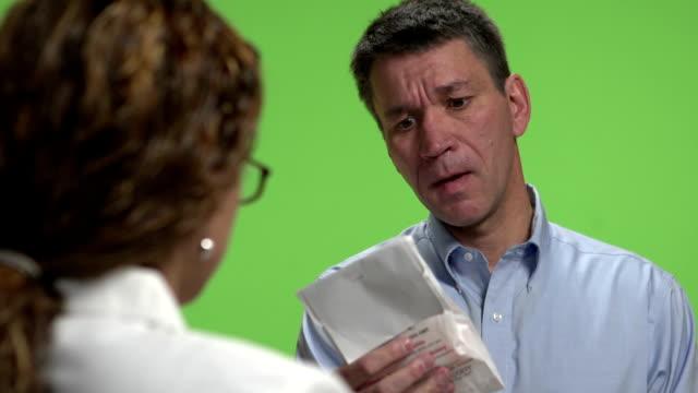Man getting a Prescription drug. Green screen video