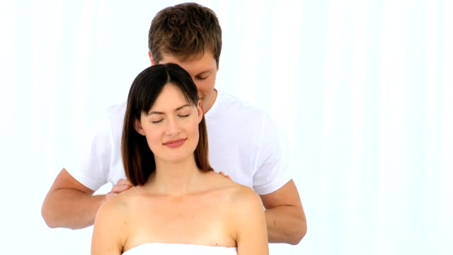 Man giving a massage to his young wife video