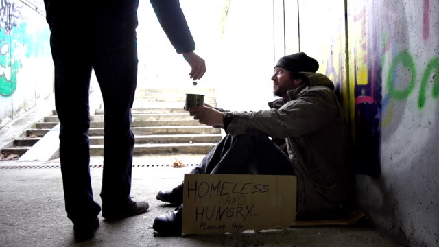 HD SUPER SLOW-MO: Man Giving Coins To A Homeless Person video