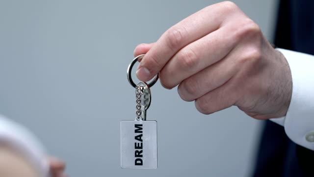 man giving woman keychain with dream word, motivation concept, leadership - key ring stock videos & royalty-free footage
