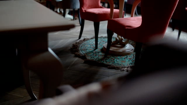 Man going between tables in the restaurant