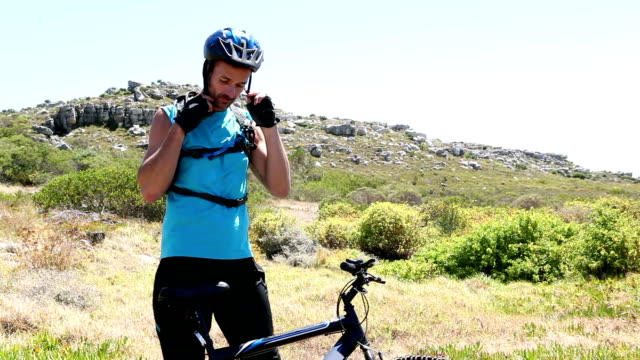 Man going cycling putting helmet on video