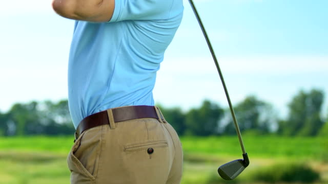 Man golf player feeling sharp back pain during swing, professional trauma