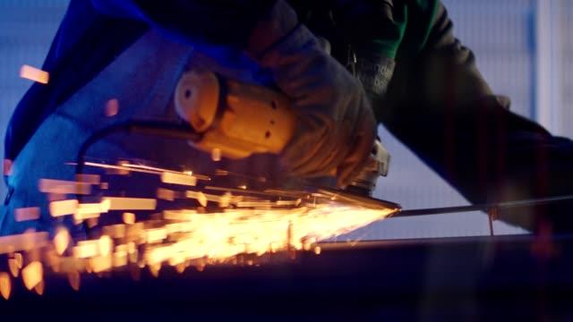 Man grinding metal Man grinding metal in the factory steel mill stock videos & royalty-free footage
