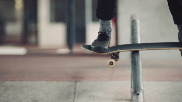 Man grinding over rail with skateboard video