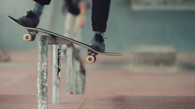man grinding over rail with skateboard - skateboarding stock videos and b-roll footage
