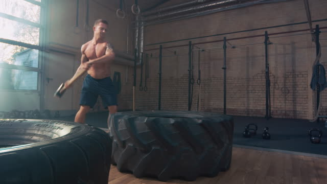 Man hammering on big tire video