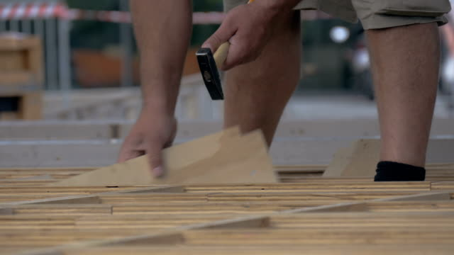 Man Hammering Wooden Boards video