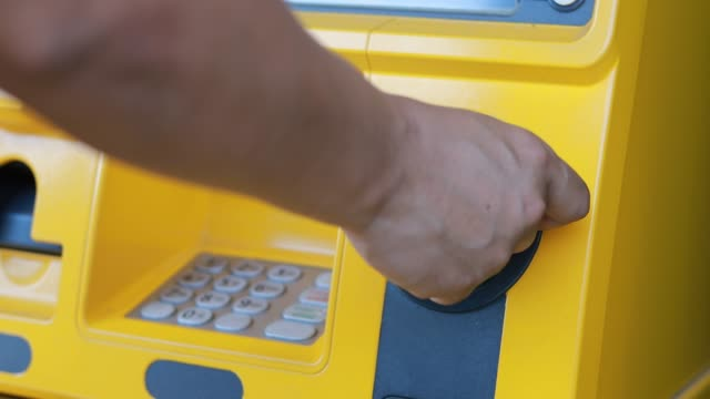 A man hand insert a debit card and entering PIN/pass code on ATM/bank machine keypad A man hand insert a debit card and entering PIN/pass code on ATM/bank machine keypad banks and atms stock videos & royalty-free footage
