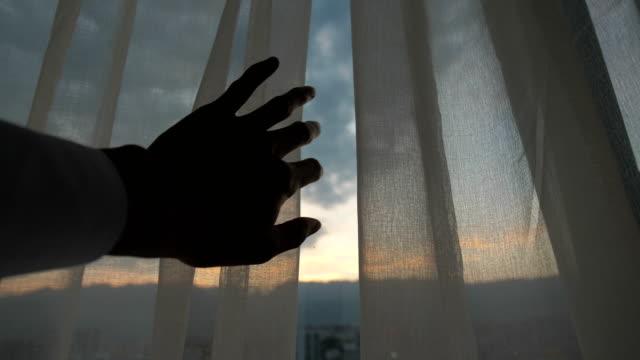 Man hand open curtain