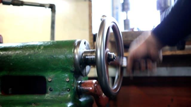 man hand operating old controls of turning machine - leva video stock e b–roll