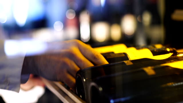 man hand taking bottle of wine from the shelf - affluent lifestyles stock videos & royalty-free footage