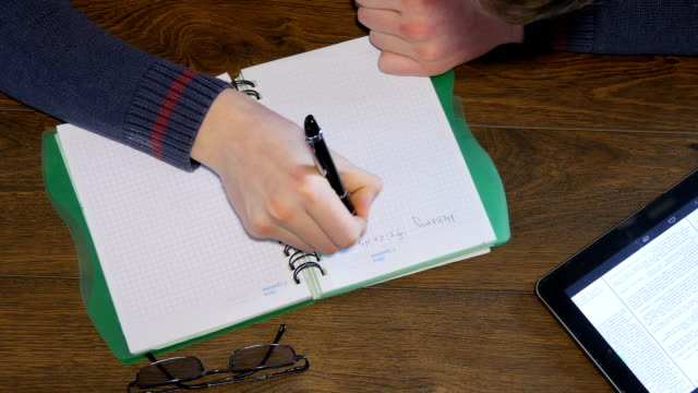 Man Hand Writing On Notepad video