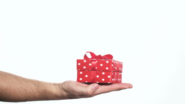 man handing red gift box to a woman video