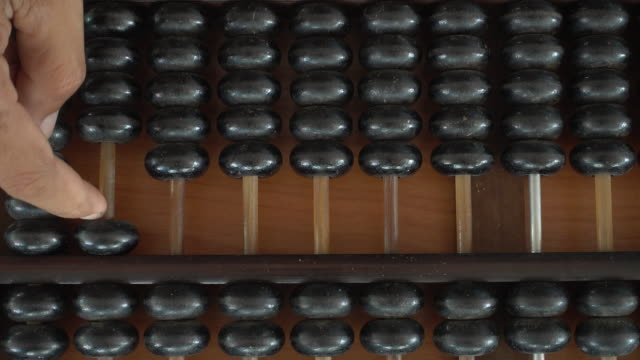 Man hands are operating abacus video