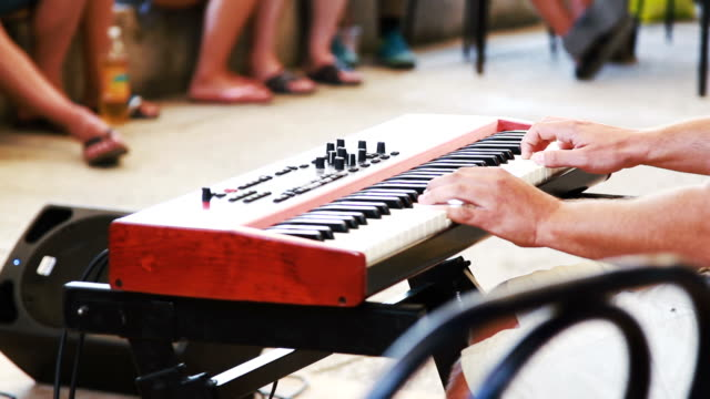 man hands play on the music synthesizer video