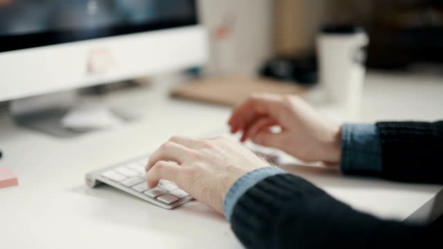 Man hands typing on keyboard computer video