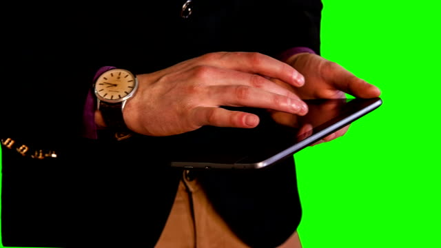 man hands work with tablet green screen video