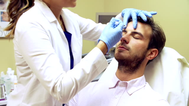 Man Having Botox Treatment At Beauty Clinic video