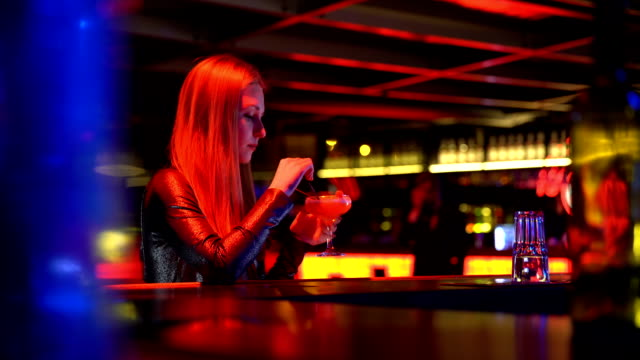Man hesitates to get acquainted with pretty woman sitting alone at bar counter Man hesitates to get acquainted with pretty woman sitting alone at bar counter aperitif stock videos & royalty-free footage