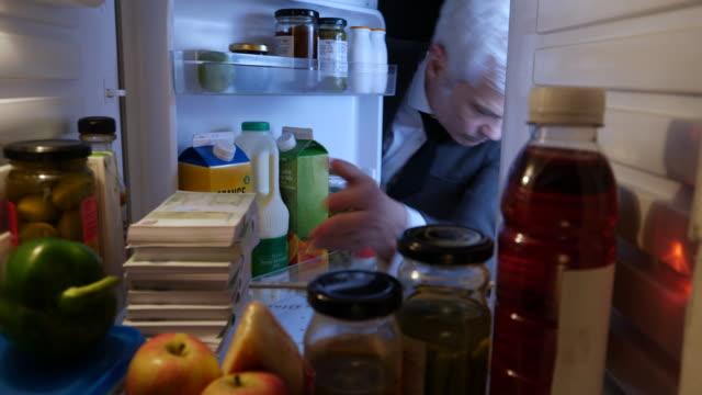 POV Man hiding stacks of Euros in a fridge video