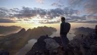 istock Man hiking  in mountains  on Senja island in fog 1203582188