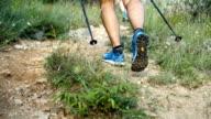 istock man hiking on mountain trail 1257997150