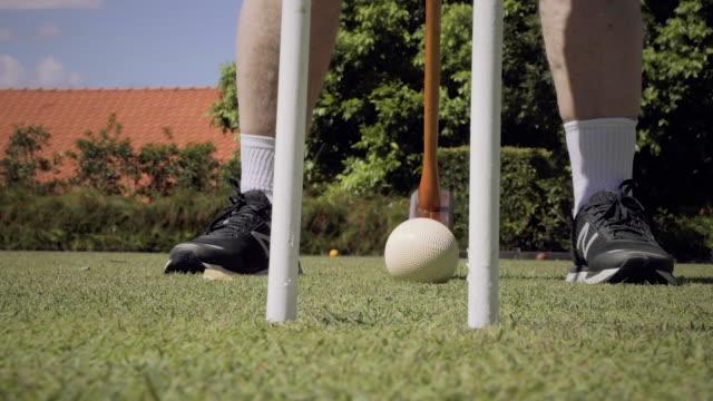 man hits a croquet ball - target australia stock videos & royalty-free footage
