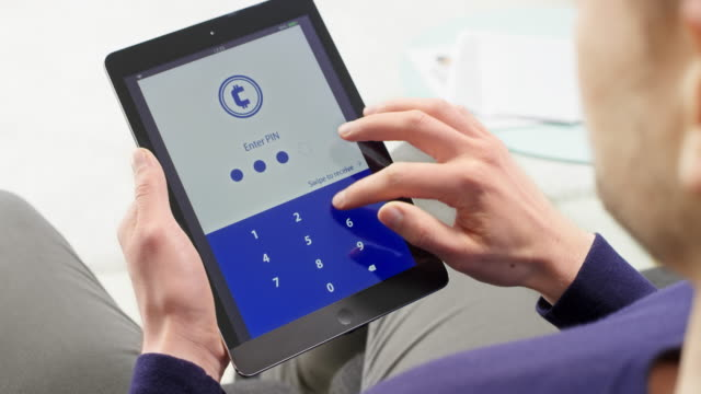 Man holding a digital tablet and checking the statistic of the cryptocurrency value