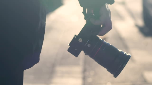 Man holding camera, walking on street, paparazzi chasing celebrity, closeup Man holding camera, walking on street, paparazzi chasing celebrity, closeup camera photographic equipment stock videos & royalty-free footage
