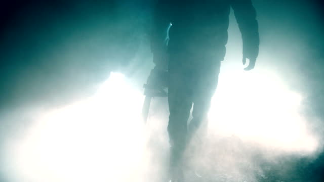 man holding chainsaw at night - motosega video stock e b–roll