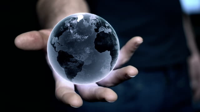 Man holding earth model in his hand. Globalization metaphor video