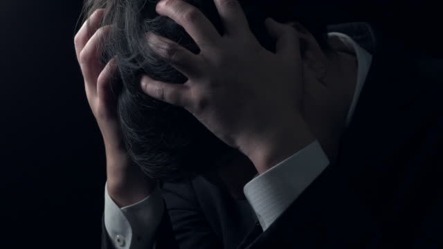 Man holding his head Man holding his head bankruptcy stock videos & royalty-free footage