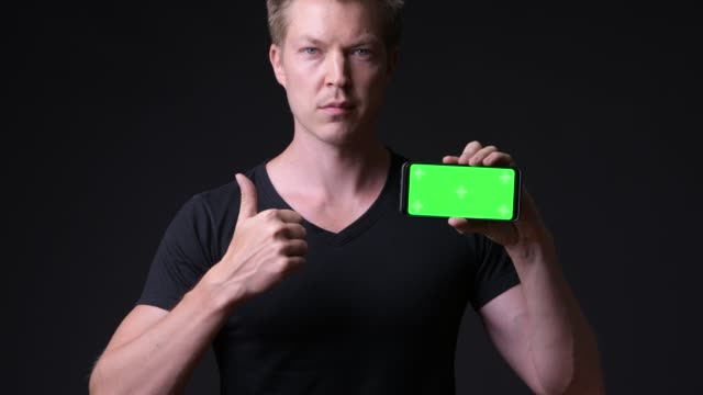 Man Holding Mobile Phone With Chroma Key Green Screen video