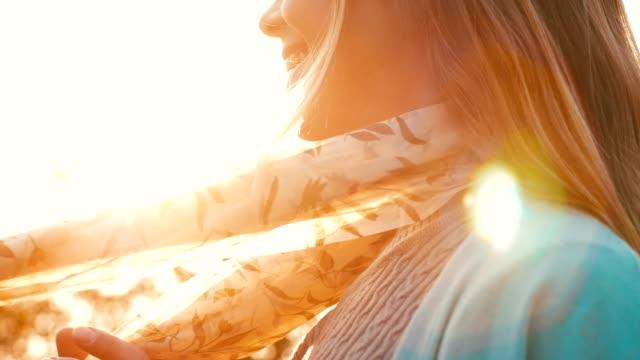 man holding woman's scarf - шарф стоковые видео и кадры b-roll