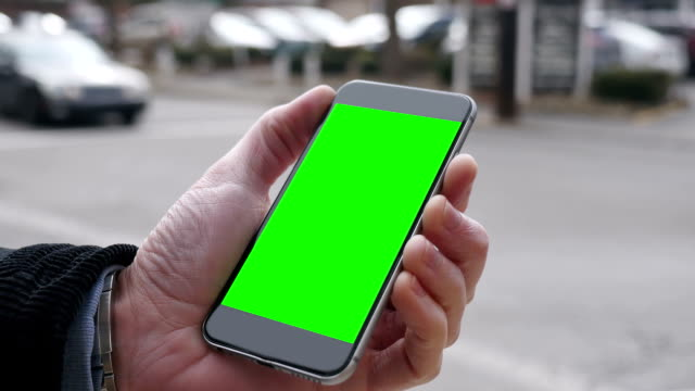 Man Holds Green Screen Smartphone in a City video
