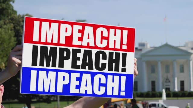 Man Holds Impeach Sign in Front of White House video