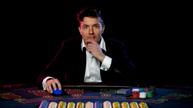 Man in a casino winning on the roulette. Close up video