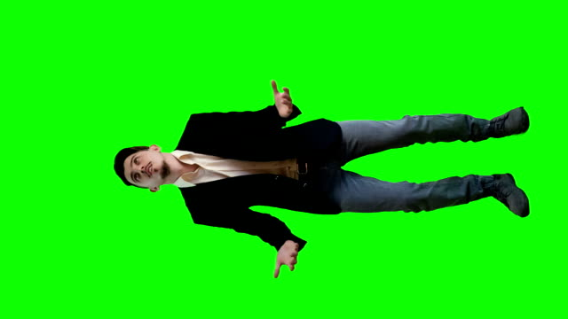 A man in a jacket on a background of the delights of a green screen
