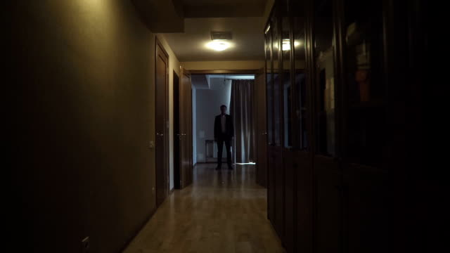 Man In A Suit In A Dark Room video