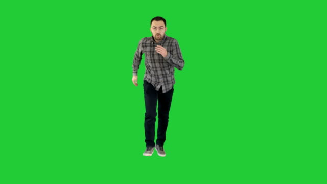 Man in casual speeding up and starts running fast on a Green Screen, Chroma Key Full length portrait. Man in casual speeding up and starts running fast on a Green Screen, Chroma Key. Professional shot in 4K resolution. 004. You can use it e.g. in your commercial video, business, presentation, broadcast east stock videos & royalty-free footage